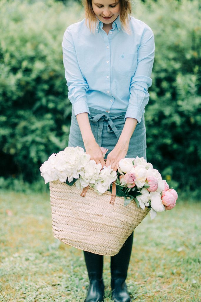 Happy florist telling she is opening a new flower studio // Helmivillakko Floral Design, Finland. Photo: Petra Veikkola