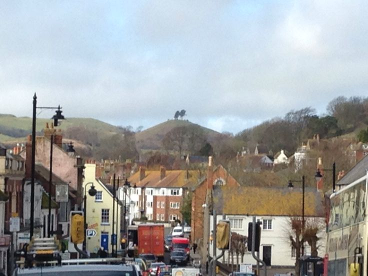Symondsbury from Bridport high street.  This strange hill is a symbol of West Dorset.  Miss u all the time!