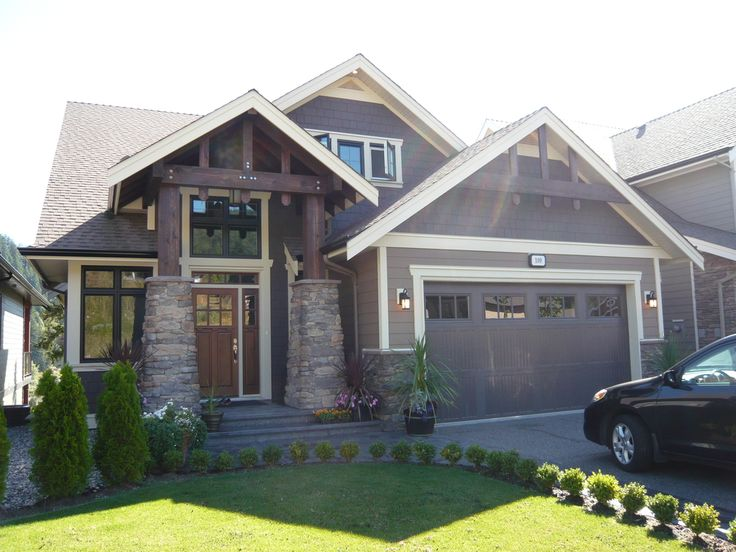 Rock Posts, Dark Brown Cedar Beams, Hardi-Plank Siding, Black Window Frames