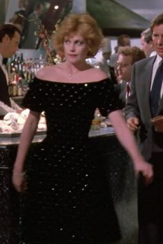 Tess dips into Katharine's closet for an executive evening image and picks a black velvet dress so fresh it still carries a $6,000 price tag.