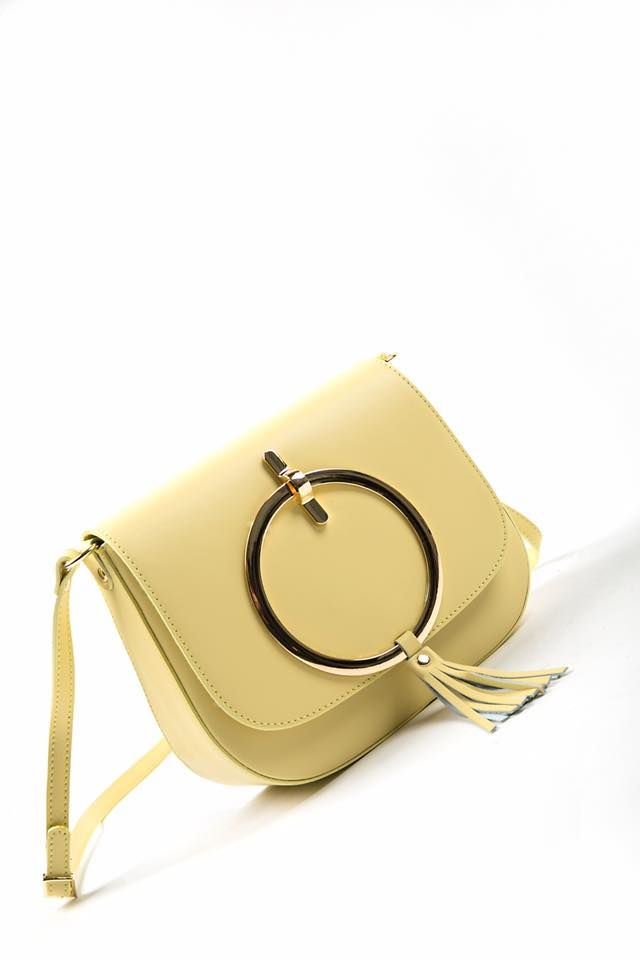 Leather crossbody bag. Rounded detail and fringed on the foldover flap. Adjustable chain shoulder strap with gold details. Back zip pocket. Suede interior foldover flap and interior lining with zipped pocket. Magnet front closure and zip inside fastening. Genuine leather. Made in Italy.   https://www.modaboom.com/leather-crossbody-with-rounded-detail-yellow.html