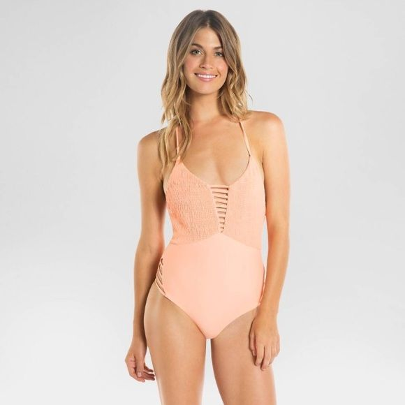 Coral/salmon Tori Praver strappy one piece NWOT New without tags but still has the hygienic panty liner. Super cute Tori Praver strappy low back one piece. Tori Praver Swimwear Swim One Pieces