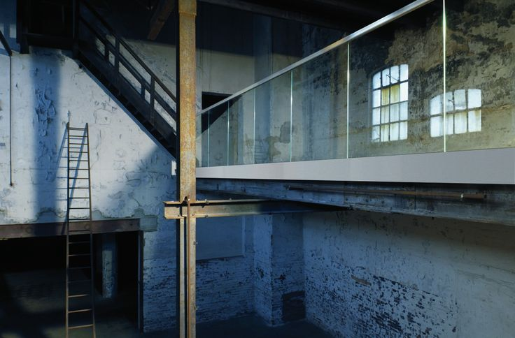 Industrial warehouse with stainless steel balustrade - cool combo!