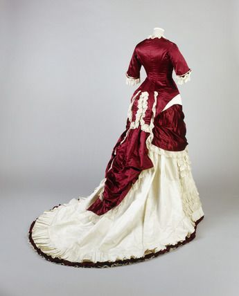 Deep red silk and ivory grosrain evening dress, ca. 1874-1879. Cuirasse bodice with ivory machine-made lace and pleated cream silk satin trim.