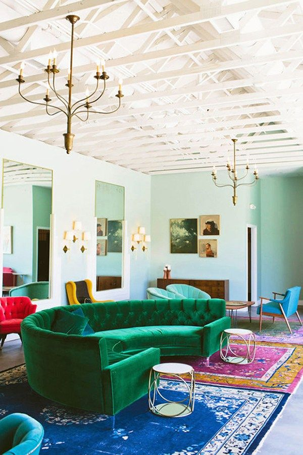 green sofa in a bright, bold space