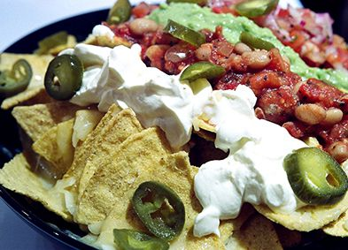Crispy corn tortilla chips, cheese sauce, beans, salsa and sour cream, jalapenos and guacamole! WOW