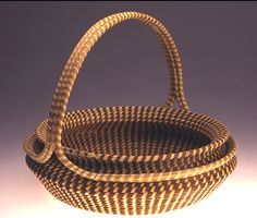 Sweetgrass basket designed and woven by Mary Jackson, MacArthur Fellowship winner and descendent of the Gullah community of Mount Pleasant, SC