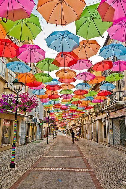Every July, as part of Ágitagueda art festival, hundreds of umbrellas are hung over promenades in the streets of Águeda, a municipality in Portugal. The beautiful tradition started only 3 years ago, but has already earned world fame for the place. #portugal #festival #europe