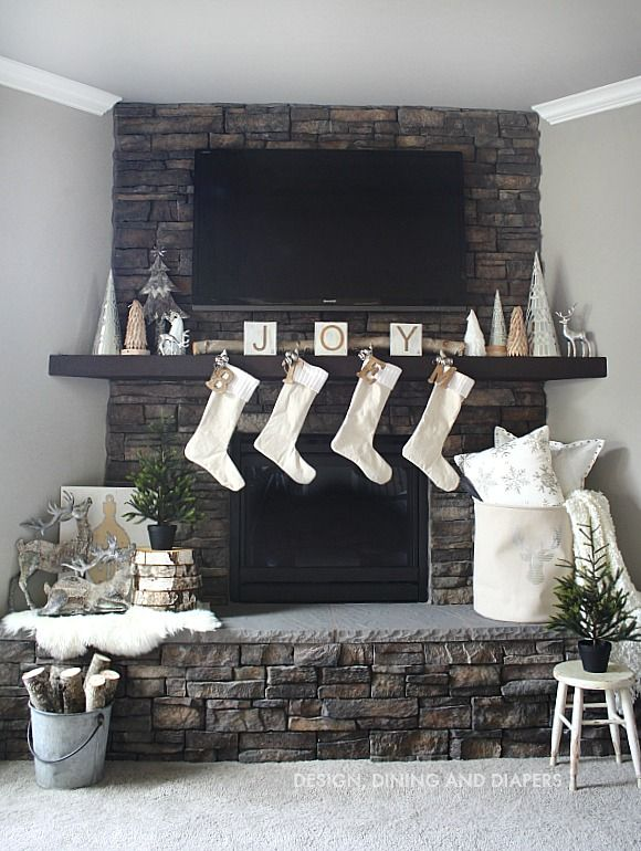 Winter White Christmas Mantel with lost of texture and pops of wood.