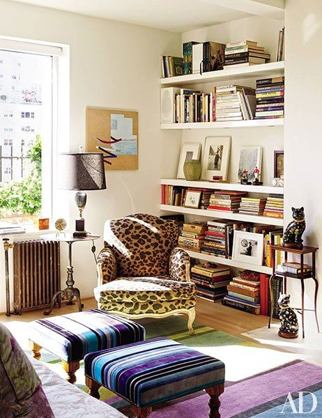 An armchair and a pair of George Smith ottomans in the den of Isaac Mizrahi and Arnold Germer's home are clad in Isaac Mizrahi for S. Harris fabrics.