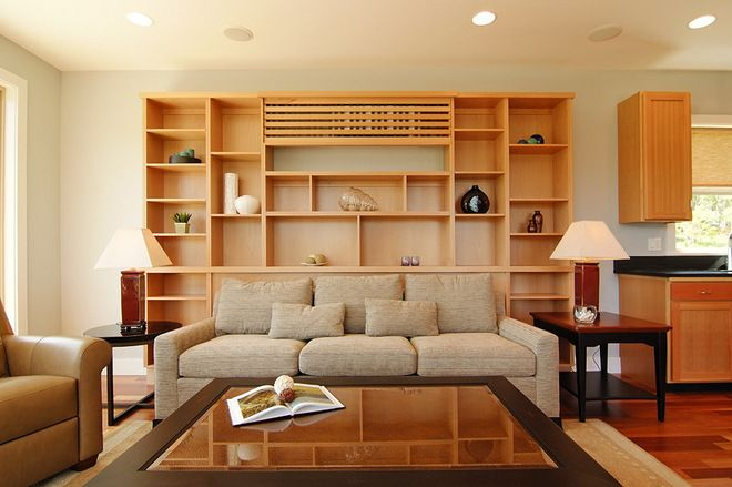 Hide AC - Create a custom cover that's integrated with your furniture. With a bit of custom design, you could even add a cover (making sure the uni...