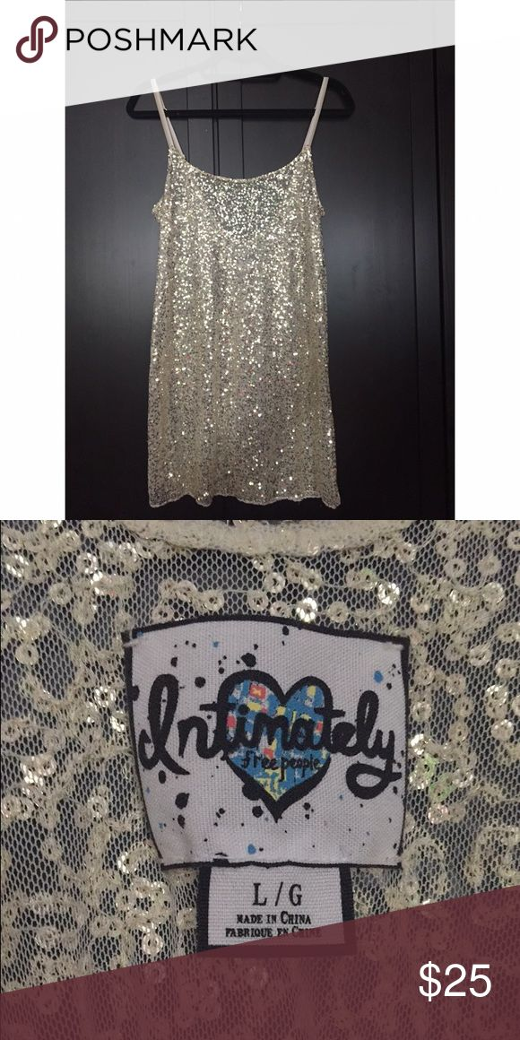 Free People sequin dress Beige sequin dress, worn once! Adjustable straps, size large. Offers welcome :) Free People Dresses Mini