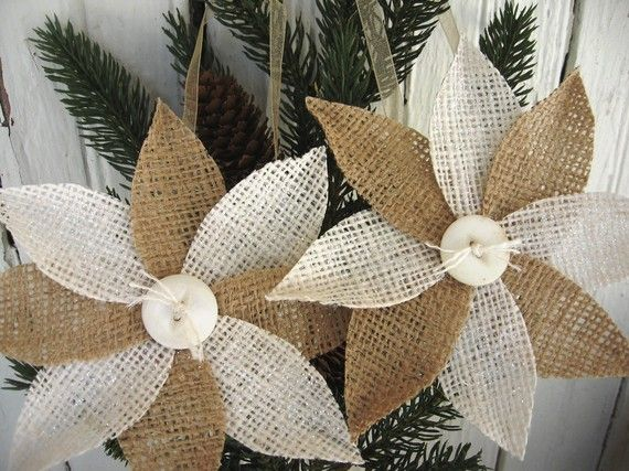 "Burlap poinsettia ornaments.  DIY...They have a touch of clear glitter to add some sparkle and a vintage button for the center. They hang from an organdy ribbon and are finished on the back with a round of felt. They measure 5.5"" across"