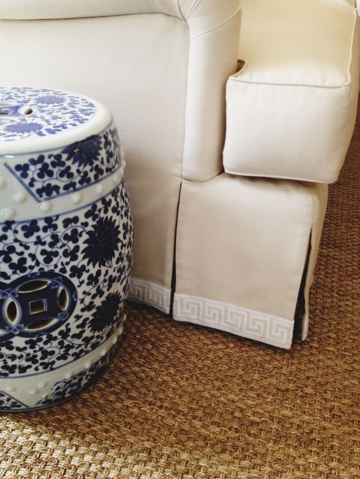 blue and white garden stool greek key trim natural fiber rug grant
