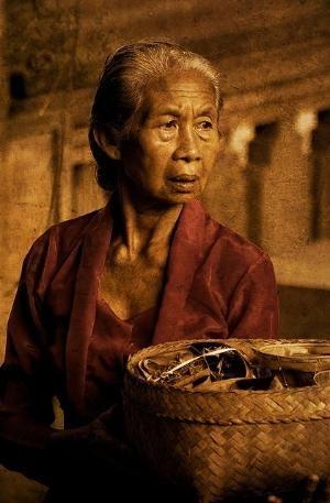 Woman in the Ubud market in Bali by alena.davydenko