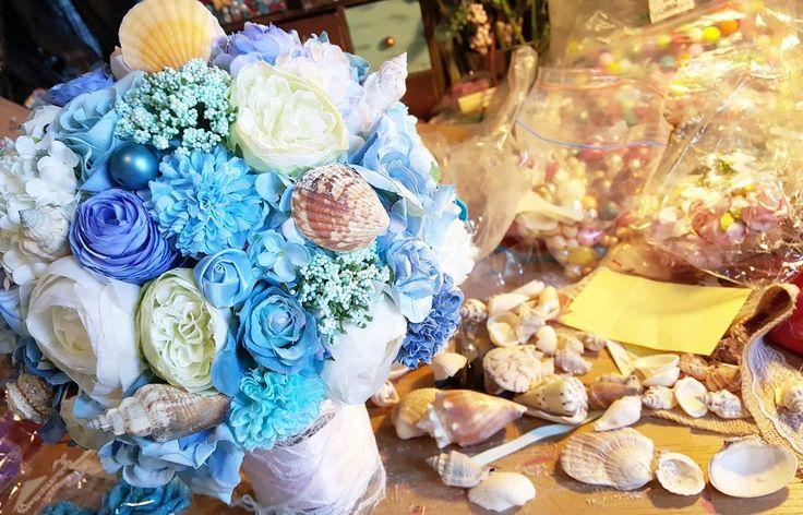 Working  Ocean theme shell bouquet . . . . . .  #silkflowerbouquet #artificialflower #wedding #floral #flower #handmade #bouquet  #flowerarrangement #pretty #lastlonger  #bridebouquet #creatives #design #love #bayarea #shell #weddingdecorations #decorationideas #artificial #bride  #bouquets #blue #oceantheme  #pretty #bayareaweddin #bayareaflorist #grooms #花球 #手作 #bayareabride http://gelinshop.com/ipost/1524335709673134224/?code=BUnh0BtgpiQ