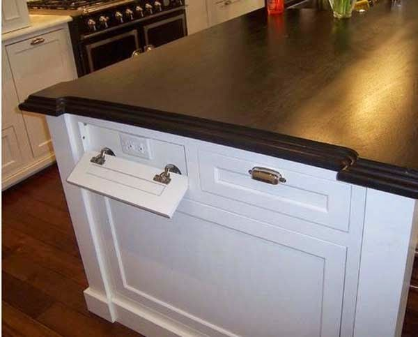 Put outlets in false drawers to optimize space.
