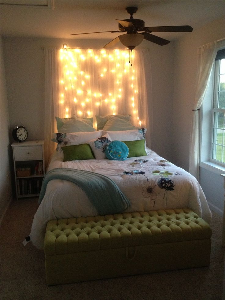 DIY light headboard! Just some shear curtains with white Christmas lights behind for a soft glow.