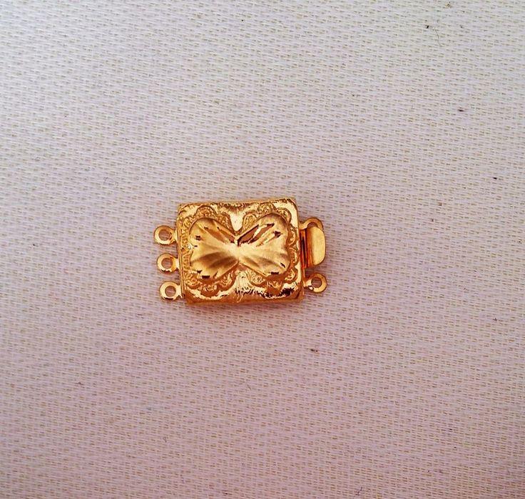 chiusura a 2  fili in metallo dorato