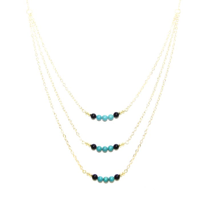 ValentinaNecklace - Turquoise & BlackOnyx -  The ultimate statement piece in our debut collection, our Valentina necklace is your instant route to sure-fire sophistication and glamour. Add to an open neckline or cocktail dress, shimmer through your evening and bask in its alluring power.  Made using our sparkling 14 carat gold-plated fine chain and accentuated with turquoise and black onyx elements. Finished with a lobster clasp fastening, an extension chain and a HOLLYGALORE charm. £54.99