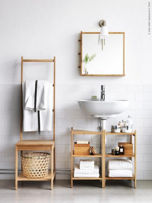 Two Ikea Corner Shelves Surrounding The Drain For Storage Under Sink