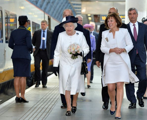 Queen Elizabeth II and Clare Hollingworth, Chairwoman of Eurostar, board the Eurostar train during a ceremony to mark the 20th Anniversary of the opening of the Eurotunnel as she departs for a State visit to France at St Pancras Station on June 5, 2014