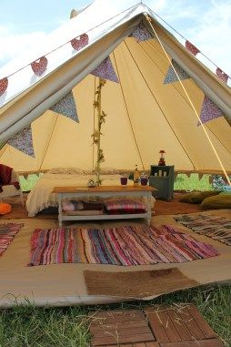 vintage bell tent with pretty bunting