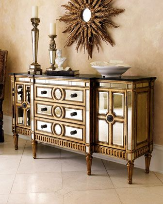 "Mirrored Console  Hardwood frame, granite top, and beveled-mirror veneers. Golden finish on frame. Three drawers, two doors, and two shelves. 70""W x 20""D x 38""T. Imported. Boxed weight, approximately 376 lbs.   Mirrored Console  Compare At: $2,182.00 Special Value: $1,849.00"