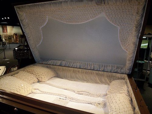 Three-person suicide coffin. The story behind this custom coffin is that a couple's infant daughter died, and they agreed to commit suicide and be buried with the daughter. At the last minute, they backed-out and never picked up the coffin from the coffin-maker. Here it rests at the National Museum of Funeral History, Houston.