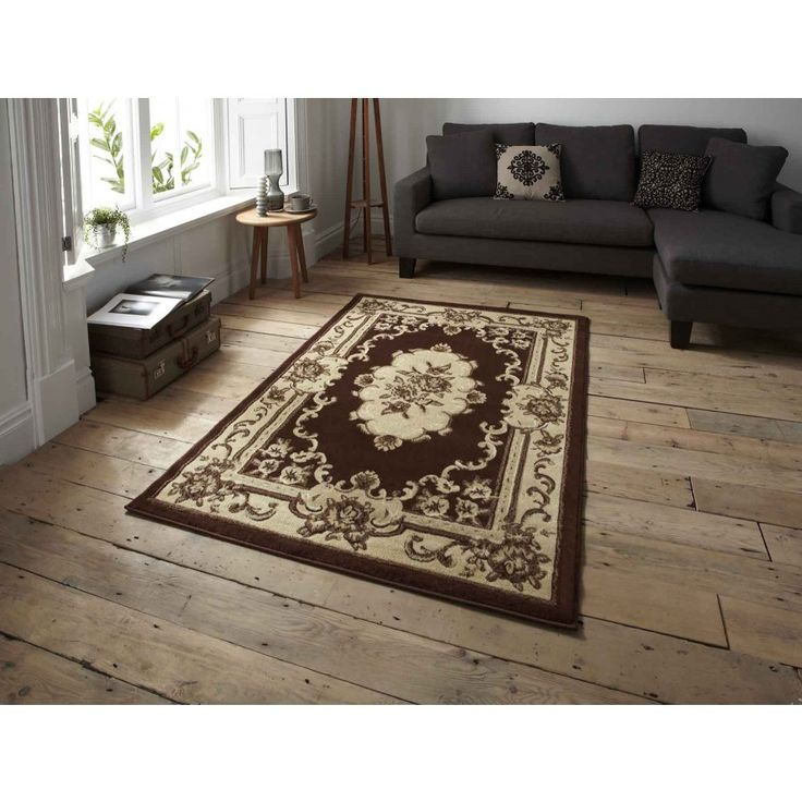 Marrakesh Brown Traditional Rug By Think Rugs Enhance your home decor with this luxurious Marrakesh Brown Traditional Rug By Think Rugs. #machinemaderugs #durablerugs #borderedrugs #floralrugs #traditionalrugs