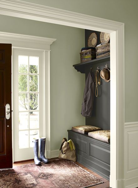 Mudroom hanging space created with paint, a bench and a shelf, not built in cabinetry! hallway in soft green and charcoal colors. by benj moore: October mist & Kendal charcoal.