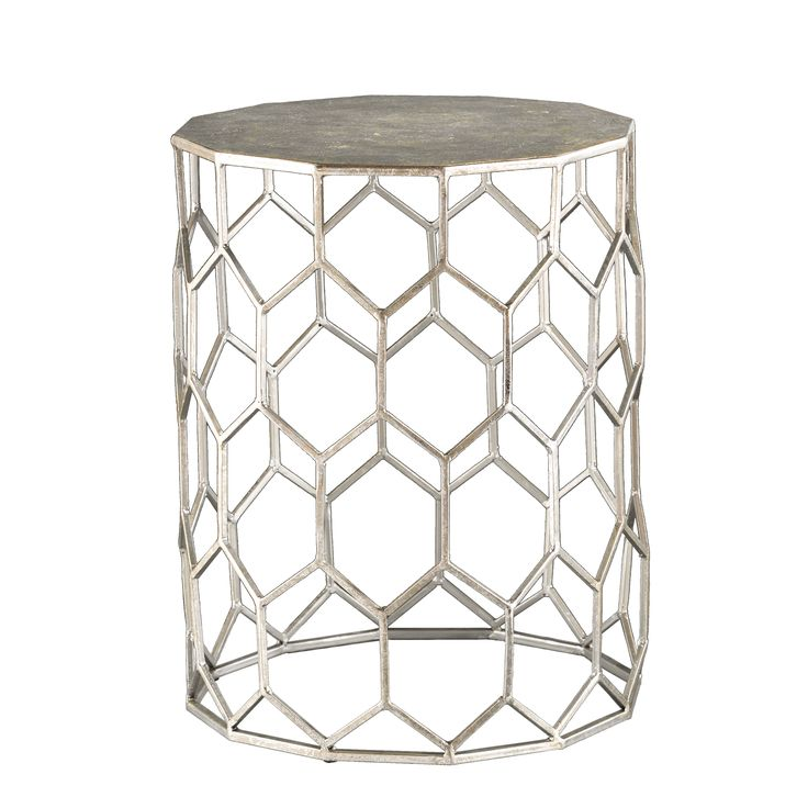 Geometrically design your life with this eclectic accent table! The honeycomb designed base supports a polygon shaped tabletop while serving as a storage area, and finished in a galvanized silver hue that gives it modern sensibility with a vintage touch.