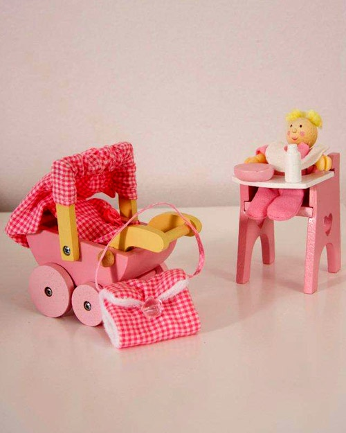 A delightful nursery set that includes a pose-able wooden baby, a buggy, a high chair and all accessories as pictured.