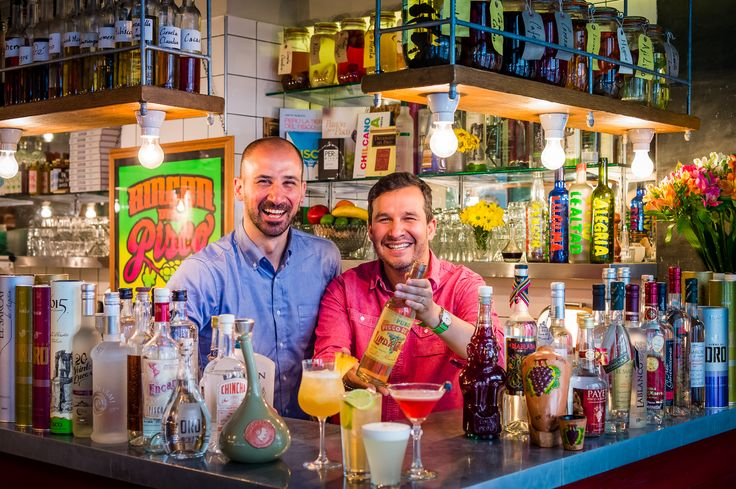 Showcasing one of the world's oldest pisco bottles at Ceviche's Pisco Bar