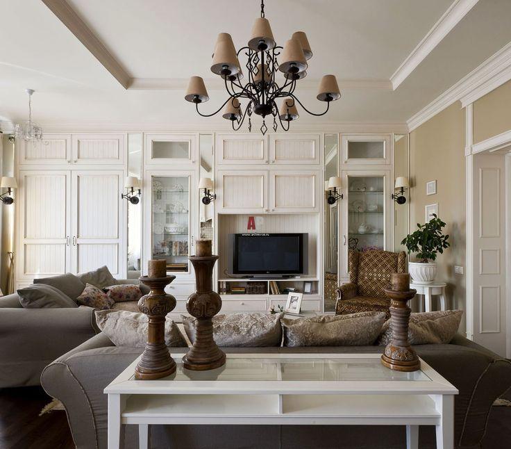 Дизайн интерьера французской квартиры в пастельных тонах с ковкой и патинированным деревом