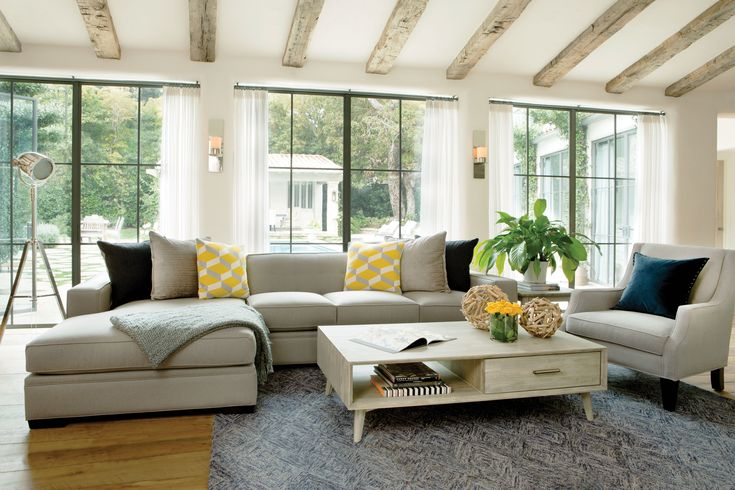 Balance a more masculine color palette with bright pops of yellow. See more inspiration rooms. #LivingSpaces