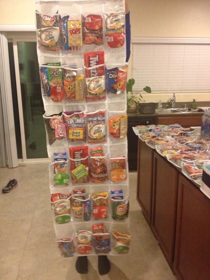 This is a fabulous high school graduation/ college send off gift. It's an over the door shoe rack filled with goodies! So many snacks fit inside here. I did sweet and savory snacks but you could also do ramen noodles, etc. Great way to package items and gift them.