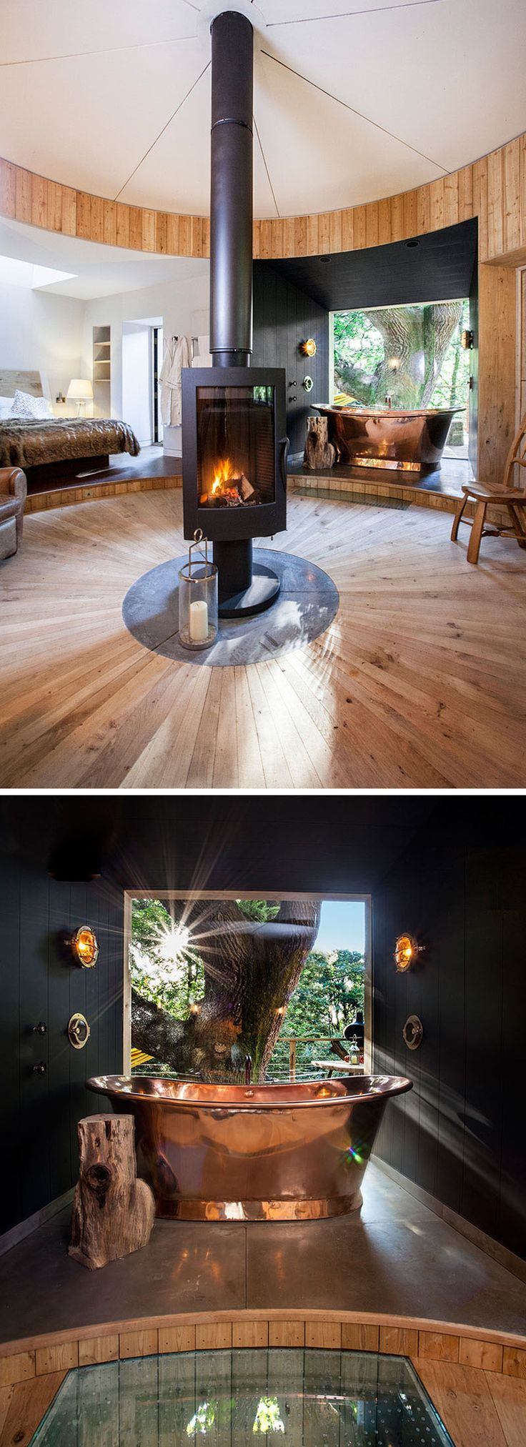 In this modern treehouse, the dark black walls are a strong contrast to the white walls of the bedroom, and a copper bath draws your eye to the space. A large floor-to-ceiling window provides uninterrupted views of the trees.