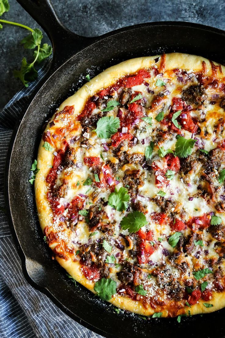 Skillet Pizza with Sausage and Chili Garlic Tomato Sauce from afarmgirlsdabbles.com #pizza #skilletpizza #castiron #sausage