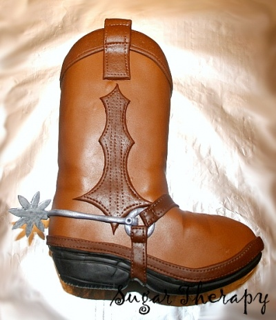 Cowboy boot cake By carmie00 on CakeCentral.com