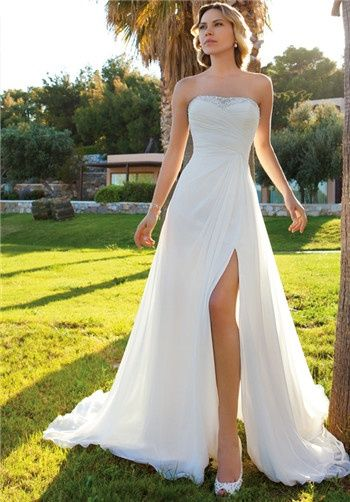 Chiffon Strapless, A-line gown with a ruched, wrap bodice, beading on neckline, and Chiffon cape.  Skirt features a high side slit and Chapel Train.