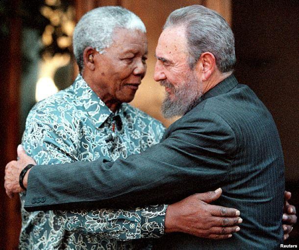 FILE - Former South African President Nelson Mandela (L) hugs Cuba's President Fidel Castro during a visit to Mandela's home in Houghton, Johannesburg, Sept. 2, 2001.