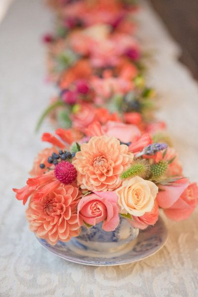 Mini bouquets in tea cups--I really like this idea. Just a touch of flowers.