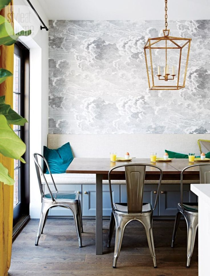 Style at Home California Cool Kitchen... Lee Hofa Cole & Son NUVOLETTE Wallpaper, Built-In Banquette with Storage and Tolix Chairs from DWR...mixed metals works really well here!