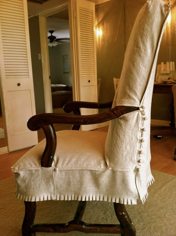 Chair Slipcover with exposed arms. Pleats on bottom, and buttons on back sides. Julia Laing Design