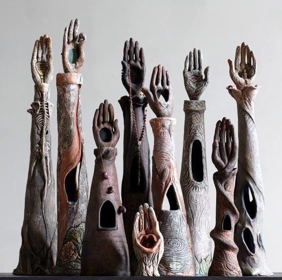Ceramic Hand Sculptures  I love these sculptures! They really stand out. They remind me of someone raising a hand to ask a question.