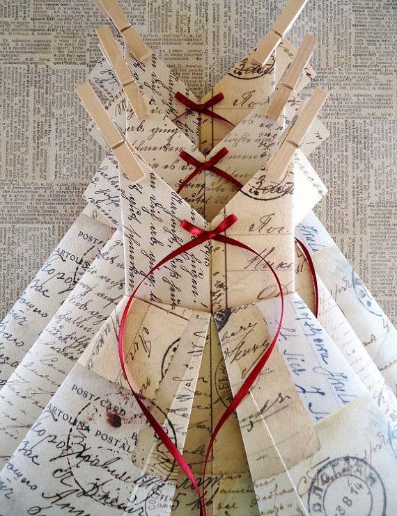 おり方は、もう知っているのだけど、可愛いデザインにすぐピンしてしまう。赤いリボンでこんなに可愛くなるのね。結局、ドレスの折り方はこれが一番シンプルでいいね。