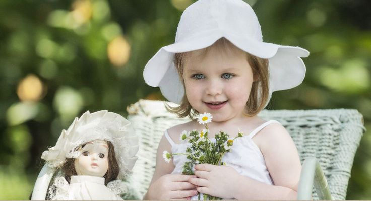 This beautiful little white petal cotton hat is handmade in South Africa - go to www.myang.co.za for more information.