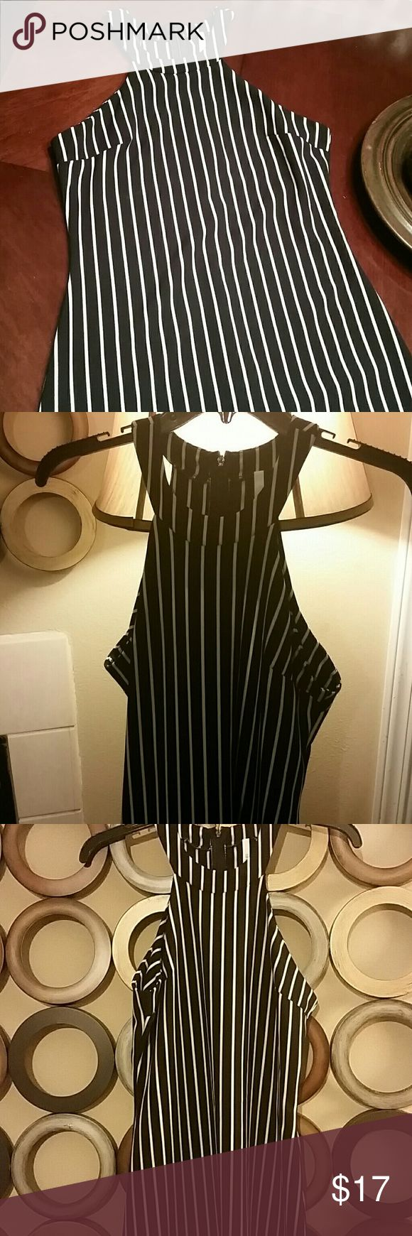 Very cute, vertical striped dress! Cute, vertical striped, black & white,  sleeveless mini dress! Back zipper. Pair with turtleneck, tights and boots or wear in the warmer months with sandals or heels. Nice! Worn once! Excellent condition! sage Dresses Mini
