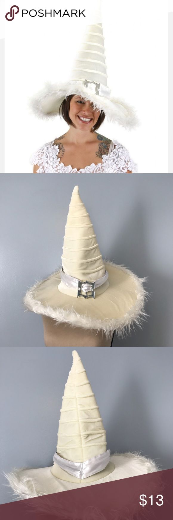 """Good Witch Plush Hat A white satin band and silver buckle on the outside and a hidden pocket inside keeps your most precious vials and charms safe. A wire brim and velcro size adjuster ensures a steady fit.  Approximate Specifications: • Item Packaged 25.5"""" x 19.5"""" x 1.5"""" • Sized for adults • An elope original product • Made with 75% Polyester/25% Cotton Elope Accessories Hats"""
